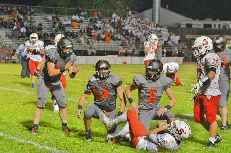 SPOTLIGHT PHOTO: JAKE MCNEAL - Senior linebackers Ross Parsons (54) and Willy Lohman (5) and the Indians' defense can bring down upstart Tillamook's best offense in four years.