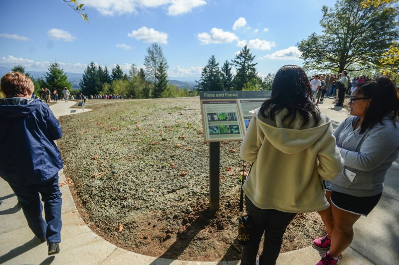 OUTLOOK PHOTO: JOSH KULLA - Close to 100 people gathered atop Hogan Butte Saturday morning for the dedication of Hogan Butte Nature Park. It features interpretive signs, native plants, and an amazing view of a half-dozen Cascade Range mountains.
