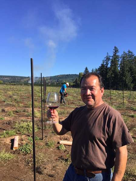 COURTESY PHOTO - Willamette Valley Vineyards manager and Forest Grove resident Efren Loeza celebrates the first planting at the Loeza Vineyards just northeast of Gaston, named in his honor.