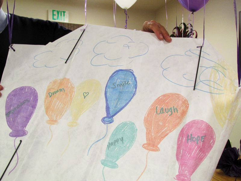 OUTLOOK PHOTO: TERESA CARSON - Memory care residents at Summerplace created hopeful messages on kites that were flown in the courtyard.