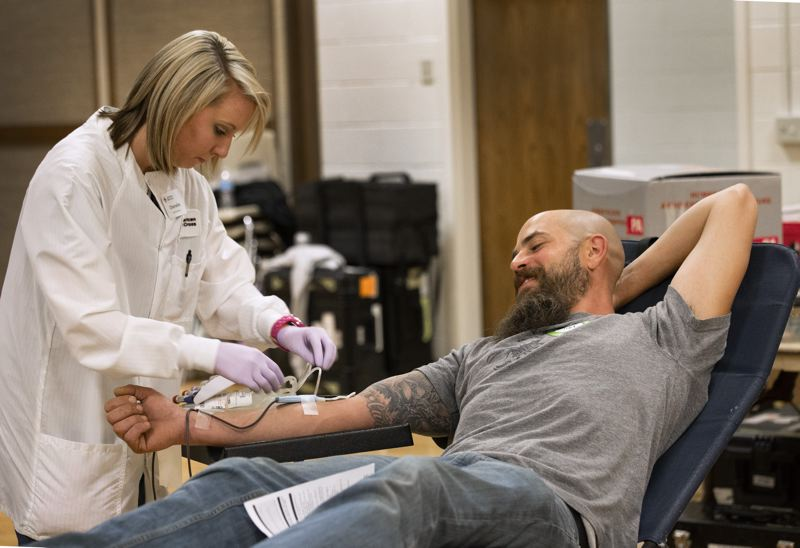 AMERICAN RED CROSS PHOTO - A blood donation in progress. Most donors are eligible to donate blood every 56 days.