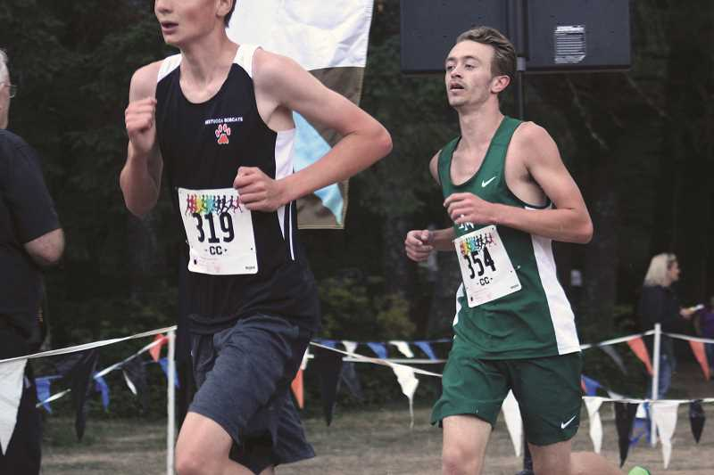 PHIL HAWKINS - North Marion junior Alex Ellington set a new personal record at the Big Cross Portland race at Pat's Acres, finishing in 19:58 for the first time under 20 minutes for the cross country veteran.