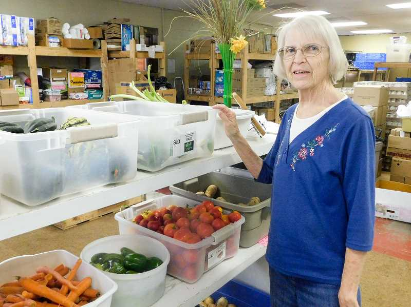 ESTACADA NEWS PHOTO: EMILY LINDSTRAND - Barbara Shibley shows off produce that the Estacada Area Food Bank has recieved from the Estacada Middle School Seed Garden. Shibley, the food bank's general manager, will retire next month.