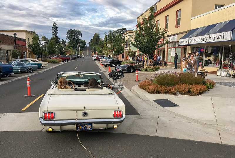 CONTRIBUTED PHOTO: BRIAN MCELROY - Actresses Willow Shields and Meg DeLacy cruise down Broadway Street in a 1965 Mustang convertible while filming 'Woodstock or Bust' last Friday.