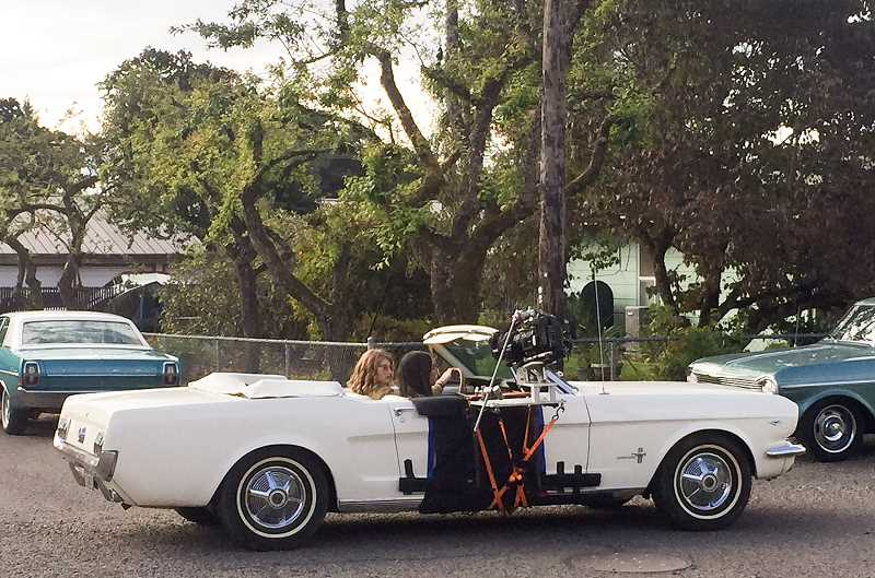 ESTACADA NEWS PHOTO: EMILY LINDSTRAND - Willow Shields and Meg DeLacy drive down Currin Street while filming 'Woodstock or Bust' in Estacada last week.