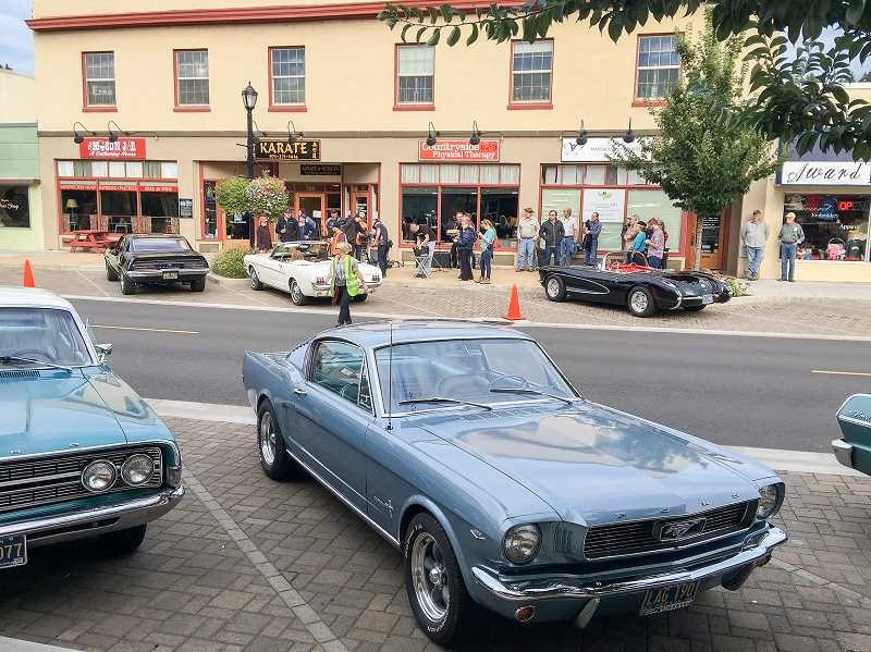 CONTRIBUTED PHOTO: BRIAN MCELROY - While filming on Broadway Street, the 'Woodstock or Bust' team placed several cars from the 1960s era to add to the film's vibe.
