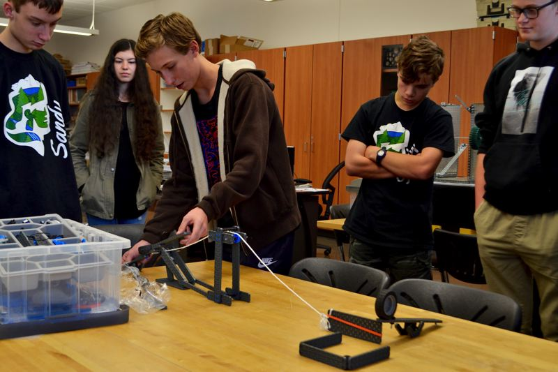 POST PHOTO: BRITTANY ALLEN - Students show off their chain reaction process projects in John Rakos' 'Intro to Robotics' class.