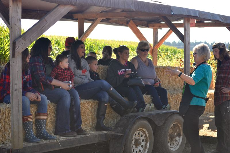 POST PHOTO: BRITTANY ALLEN - Marcia Liepold explains hayride safety precautions to eager festival attendees.