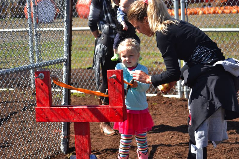 POST PHOTO: BRITTANY ALLEN - Liepold's provides apple-pult  fun for all ages with specially designed catapults.