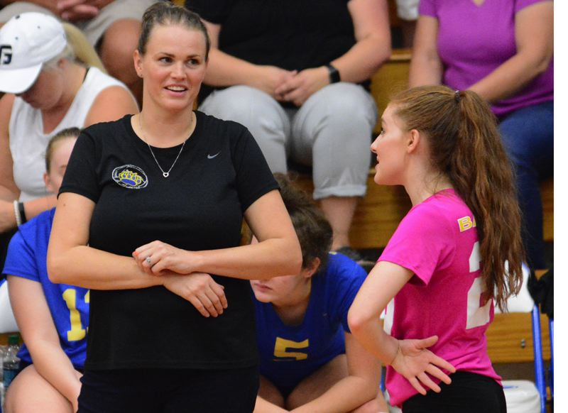 OUTLOOK PHOTO: DAVID BALL - Barlow High coach Jessie Mott shares a moment with libero Jessica Ringo before taking the floor for the third set.