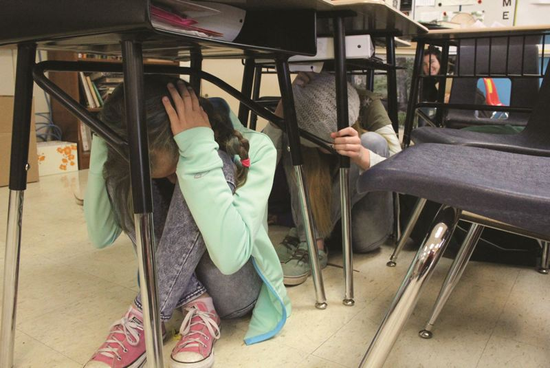 FILE - Students participate in an earthquake drill last year during the Great Oregon ShakeOut, a preparedness event.