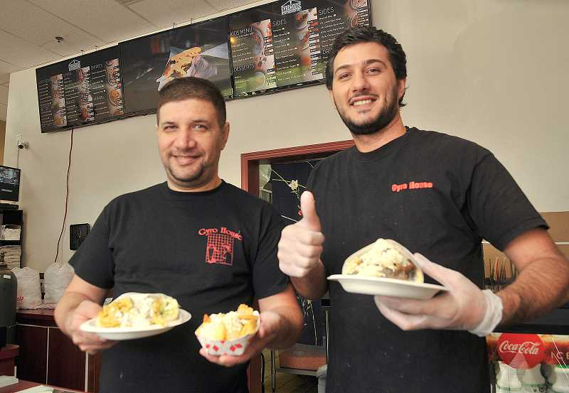 SPOKESMAN PHOTO: VERN UYETAKE - The two managers of GyroHouse are Ryan Tahi, left, and Ahmad Yaghi.