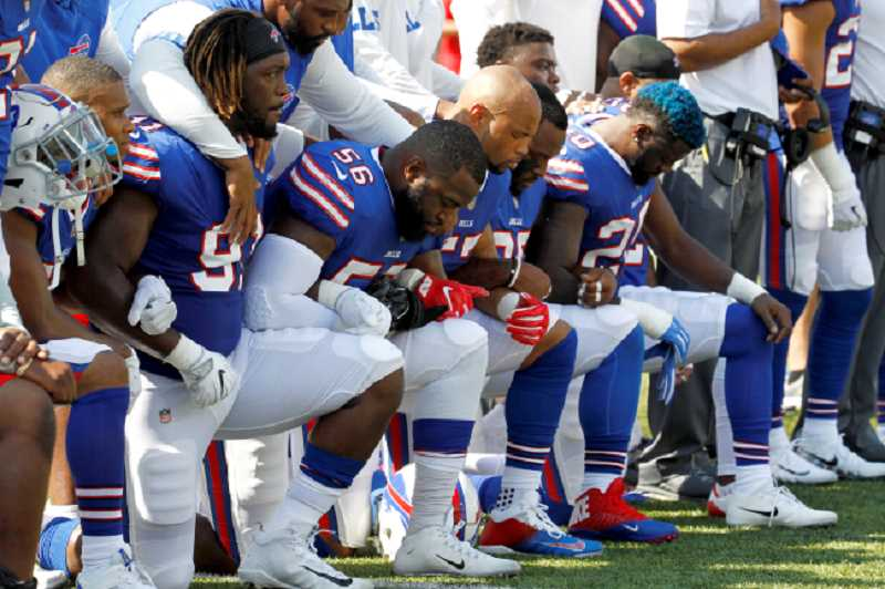 KOIN NEWS FILE PHOTO - NFL players protesting President Trumps' comments before a game last weekend.