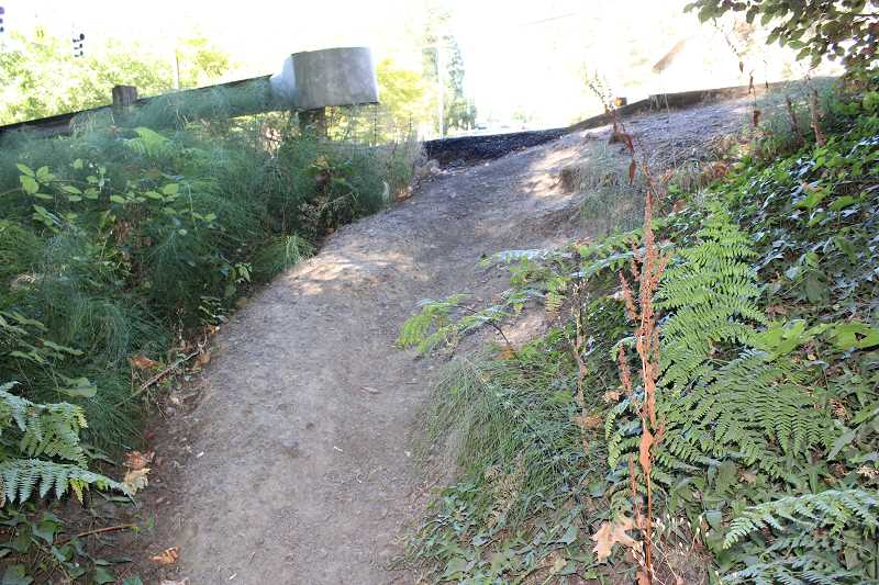 CONNECTION PHOTO: COREY BUCHANAN - Pedestrians must navigate a steep incline to enter the trail from Southwest 25th Avenue and Beaverton Hillsdale Highway.
