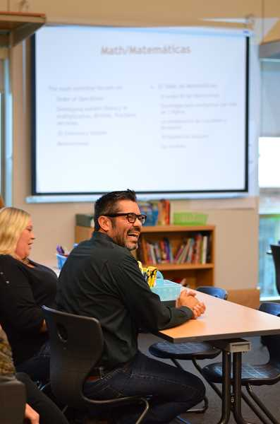 SPOKESMAN PHOTO: CLARA HOWELL  - Parents enjoy learning about their childs upcoming year at Lowries Curriculum Night.