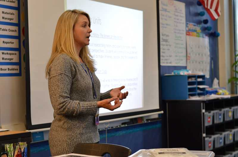 SPOKESMAN PHOTO: CLARA HOWELL  - Fourth-grade teacher Michelle Warner talks to parents and shows them what books their children will be reading. 6. The PTA introduces themselves at Lowrie Curriculum Night to spread awareness of upcoming events and fundraisers.