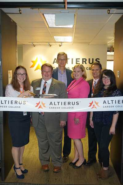 COURTESY: ALTIERUS - Altierus Executive Director Siri Dixon, Tigard Mayor John Cook and other community leaders presented a $25,000 Go! award to Megan Kovacs, executive director of Girls, Inc. of the Pacific Northwest, last Wednesday.