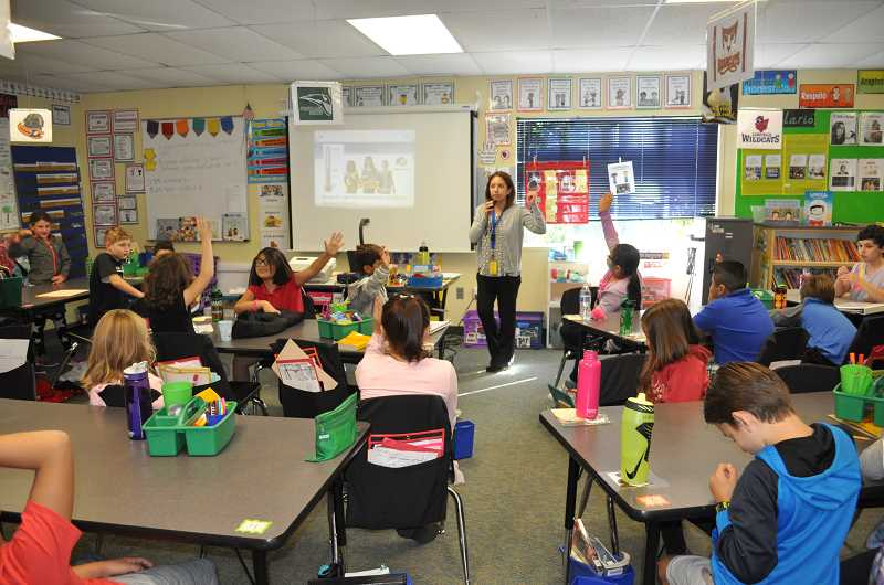 TIMES PHOTO: BLAIR STENVICK - Students raise their hands to answer a question in Patty Hoyt's third-grade class at Tigard's Metzger Elementary School.