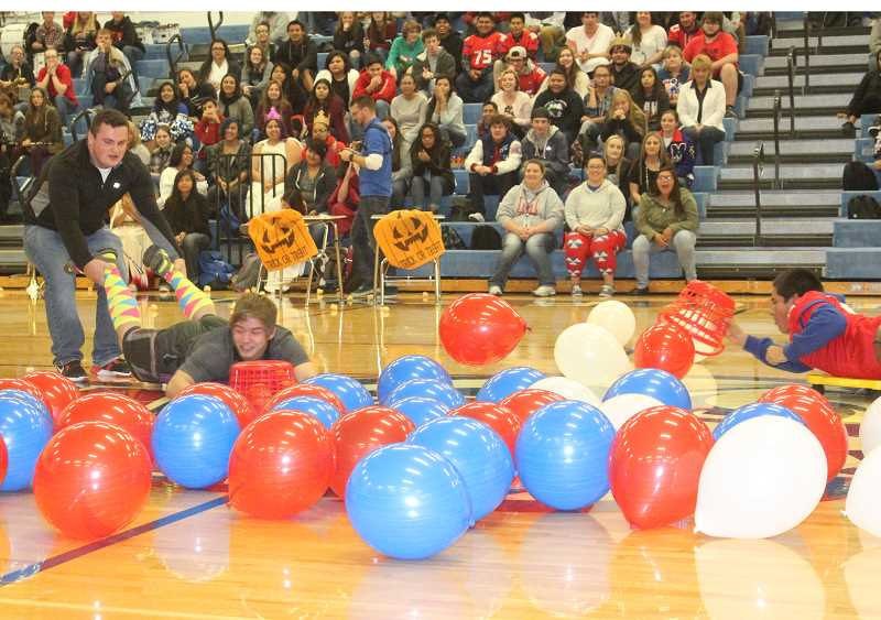 PIONEER FILE PHOTO - Students participate in a relay contest at last year's homecoming pep assembly.