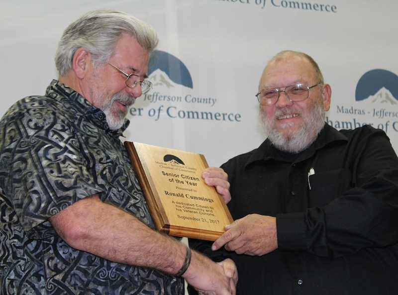 HOLLY M. GILL - Ron Cummings, left, accepts the award for Senior Citizen of the Year from Floyd Leach.
