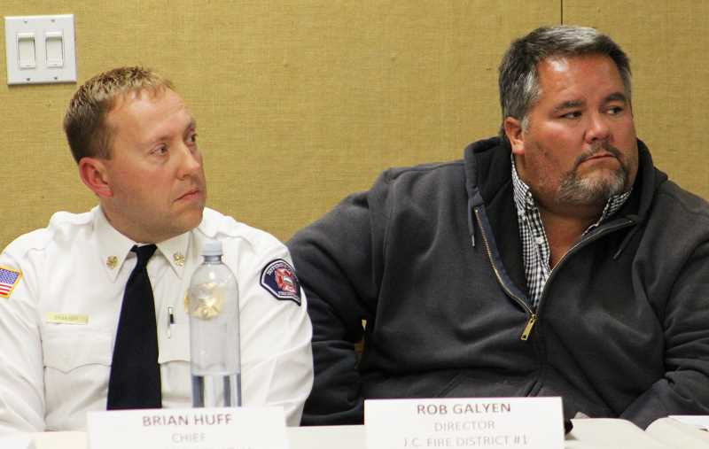 HOLLY M. GILL - Jefferson County Fire Chief Brian Huff, left, and JCFD board member Rob Galyen listen to questions from the audience during a meeting of the JCFD and Jefferson County Emergency Medical Services.