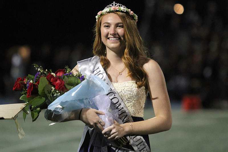 REVIEW PHOTO: MILES VANCE - Lakeridge High School senior Kendall Ensing beams after being named Holecoming Queen during halftime of the Pacers' football game on Friday night.