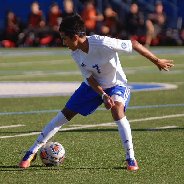 GRESHAM OUTLOOK: MATT RAWLINGS - Gresham's Diego Romero tries to keep control of the ball.
