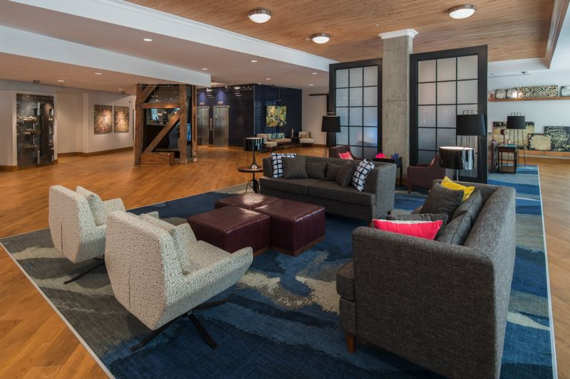 COURTESY: HAMPTON INN PEARL - The lobby at the new Hampton in Pearl District. Note the steel vault on the left and the wooden elevator components salvaged from the building it replaced.