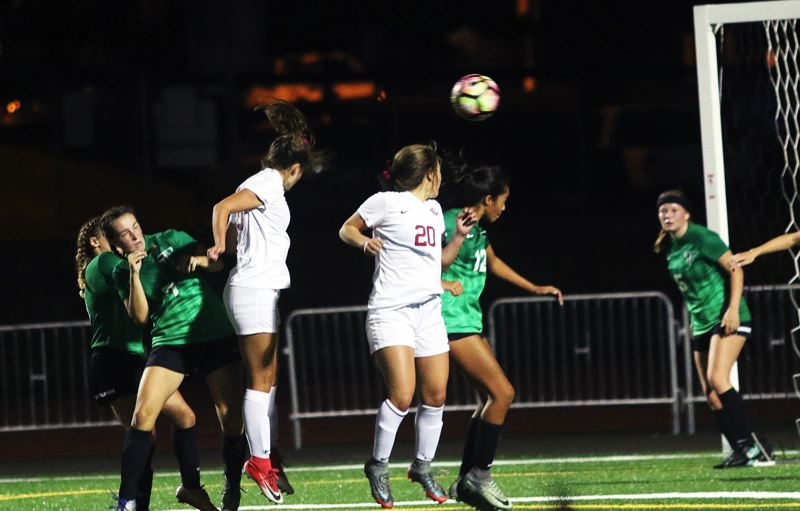 DAN BROOD - Sherwood sophomore Jillian Leroux goes up to head in this shot off a corner kick during the Lady Bowmen's match with Tigard.