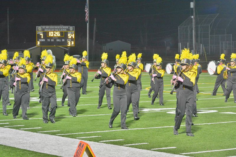 SPOTLIGHT PHOTO: JAKE MCNEAL - The St. Helens High School marching band performs during a home football game on Friday, Sept. 22. The band debuted its fall show, 'The Rise and Fall of Rome,' during halftime.