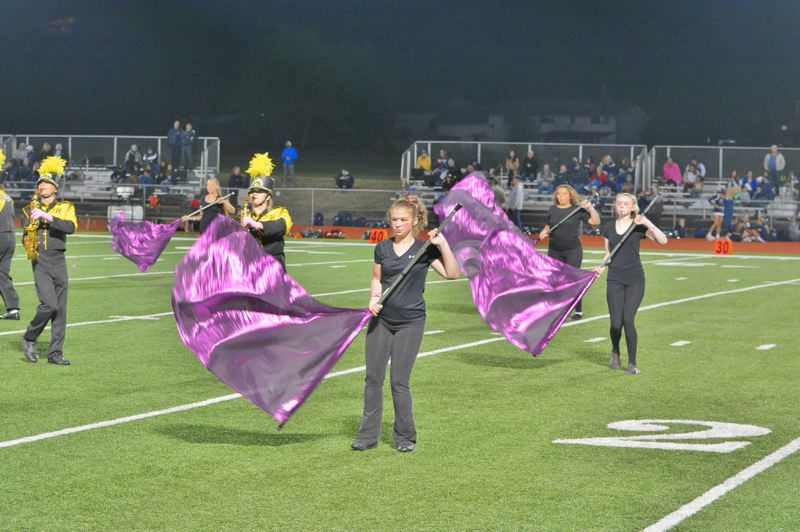 SPOTLIGHT PHOTO: JAKE MCNEAL - Members of the St. Helens High School color guard perform at a home football game on Sept. 22. The marching band and color guard spent six weeks learning their show and will head to the first competition of the season in Salem this weekend.
