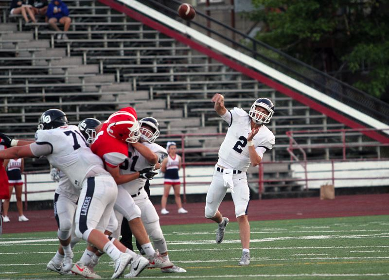 PAMPLIN MEDIA GROUP PHOTO: MILES VANCE - Lake Oswego senior quarterback Jake Dukart and the Lakers will face another tough test on Friday when they host Tualatin at 7 p.m. Friday.