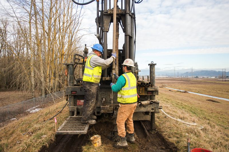 FILE PHOTO - Drillers prepare to bore 8-inch wide holes, spaced roughly 1,000 feet apart, in earthen levees along the Columbia River in Troutdale in January.