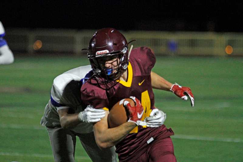 NEWS-TIMES PHOTO: WADE EVANSON - Forest Grove's Cole Smith carries the ball during the Vikings' game against McNary September 29 at Forest Grove High School.