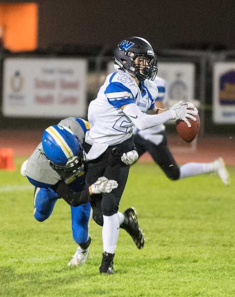 LON AUSTIN/CENTRAL OREGONIAN - Logan Madewell catches a pass over the middle for a Woodburn first down.
