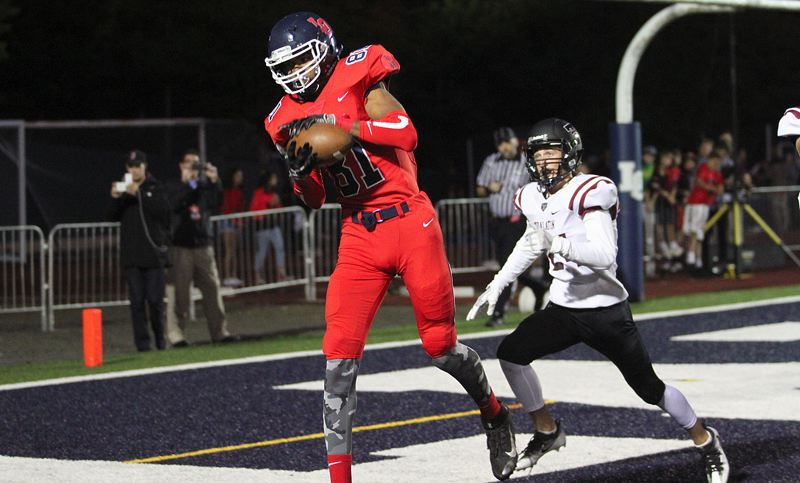 PAMPLIN MEDIA GROUP PHOTO: MILES VANCE - Lake Oswego senior wide receiver Kameron Harvey makes the first of his three touchdown catches in his team's 34-27 home win over Tualatin on Friday.