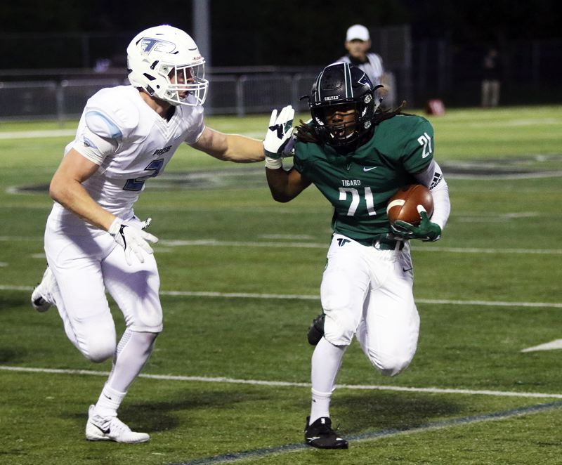 DAN BROOD - Tigard junior Malcolm Stockdale (right) ran for 128 yards and scored four touchdowns in the 48-19 win over Lakeridge.