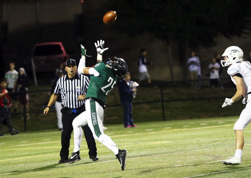 DAN BROOD - Tigard senior Braden Lenzy pulls in a 34-yard touchdown pass on the final play of the first quarter in the win over Lakeridge.