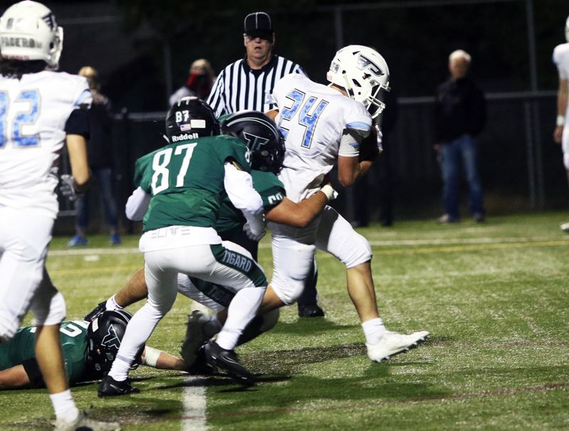 DAN BROOD - Lakeridge sophomore Caiden Biege-Wetherbee gets into the end zone for a fourth-quarter touchdown for the Pacers in Friday's game at Tigard.