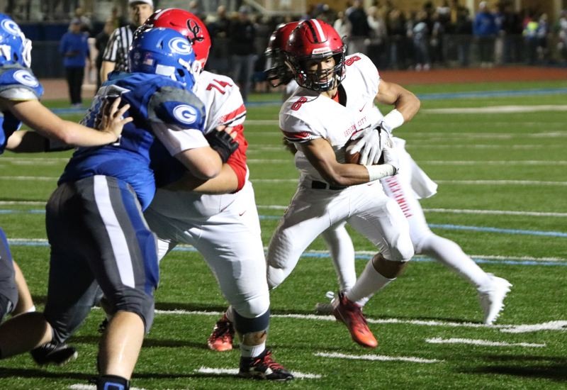 REVIEW/NEWS PHOTO: JIM BESEDA - Oregon City's Zakayas Dennis-Lee (8) follows center Kale Sorenson (74) into the end zone from a yard out in Friday's Mt. Hood Conference game at Gresham.