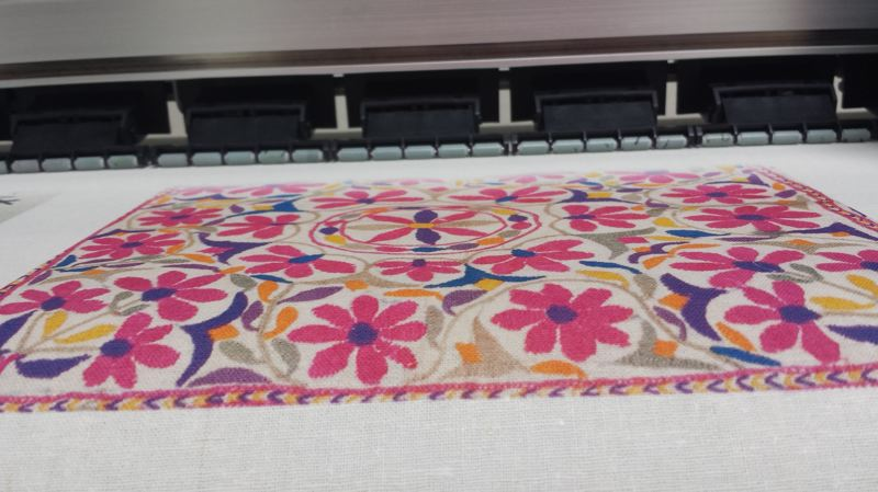 PAMPLIN MEDIA GROUP: JONATHAN HOUSE - Printed fabric comes out of the DigiTab (which is basically a giant inkjet printer) at eight yards per hour.This icomes from an original piece of needlepoint digitally sanned.