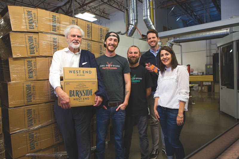 PAMPLIN MEDIA GROUP PHOTOS: ADAM WICKHAM - Grover Wickersham, Eastside Distilling chairman and CEO; Travis Schoney, Big Bottom Distilling lead distiller and production manager; Monte Costa, Big Bottom Distilling product aficianado; Trevor Thrap graphic designer at Sandstrom, Kelly Bohls, Sandstrom Design partner/project manager all celebrating the launch of the new bourbon and new branding for Eastside Distilling.