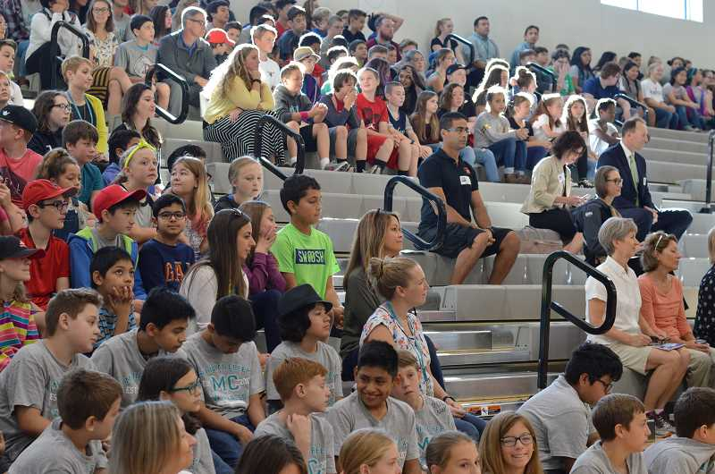 SPOKESMAN PHOTO: CLARA HOWELL - Crowds of students, teachers and administration gathered in the gym to witness the Meridian Creek Dedication Ceremony.