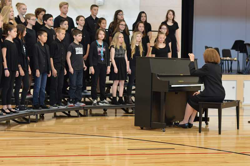 SPOKESMAN PHOTO: CLARA HOWELL - The advanced choir puts on a performance at the dedication ceremony.