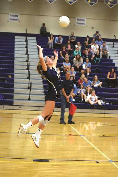 HERALD PHOTO: TANNER RUSS - Sophomore Ruby Kayser serves the ball to the Pacers. The Cougars defeated the Pacers three sets to two on Thursday, Sept. 28.