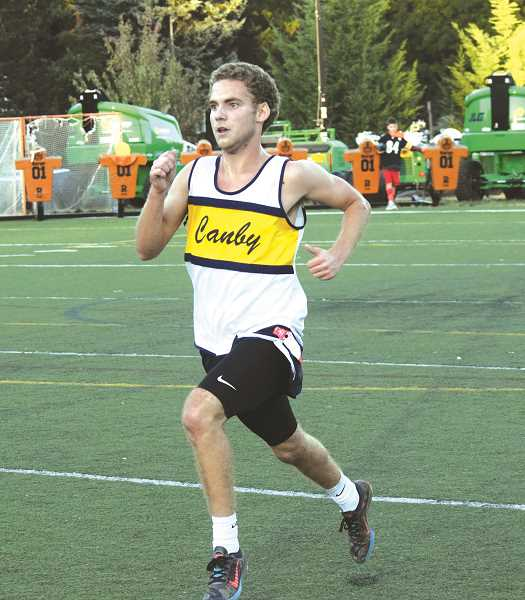 HERALD PHOTO: TANNER RUSS - Junior Cole Thomas took first place in the boys varsity race against Tigard and Lakeridge on Wednesday, Sept. 27.