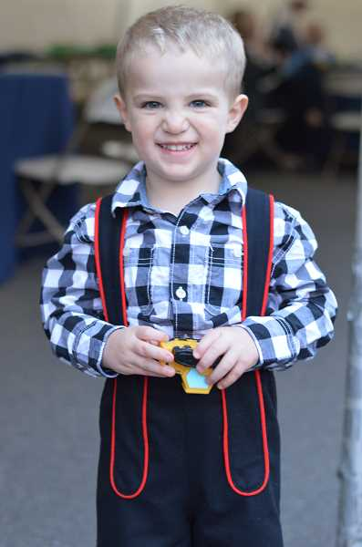 TIDINGS PHOTO: CLARA HOWELL - Tualatin resident, Parker Cain, 3, wears traditional garb — a lederhosen — and dances to the music.