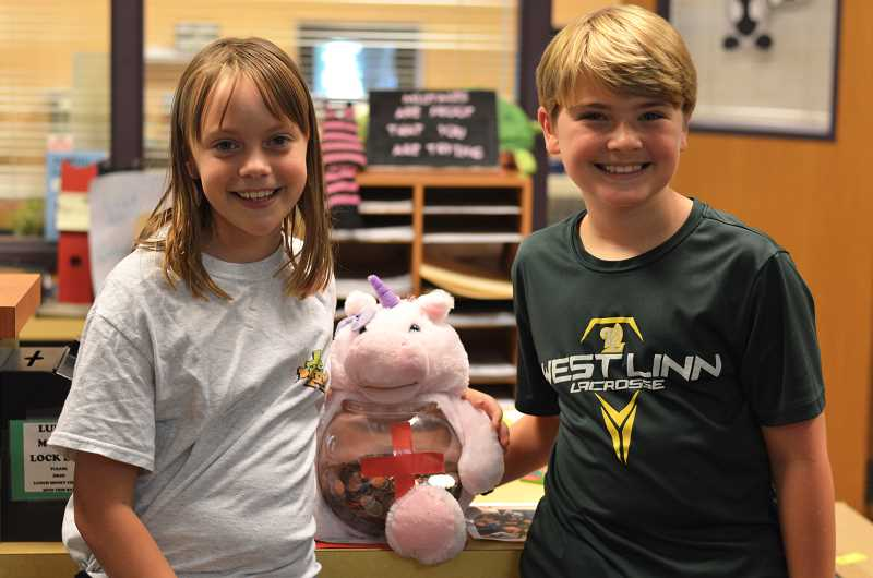 TIDINGS PHOTO: CLARA HOWELL - Willamette Primary Fifth-graders Naomi Oltmans and Zack Jordan are proud to be involved with raising money for Red Cross.