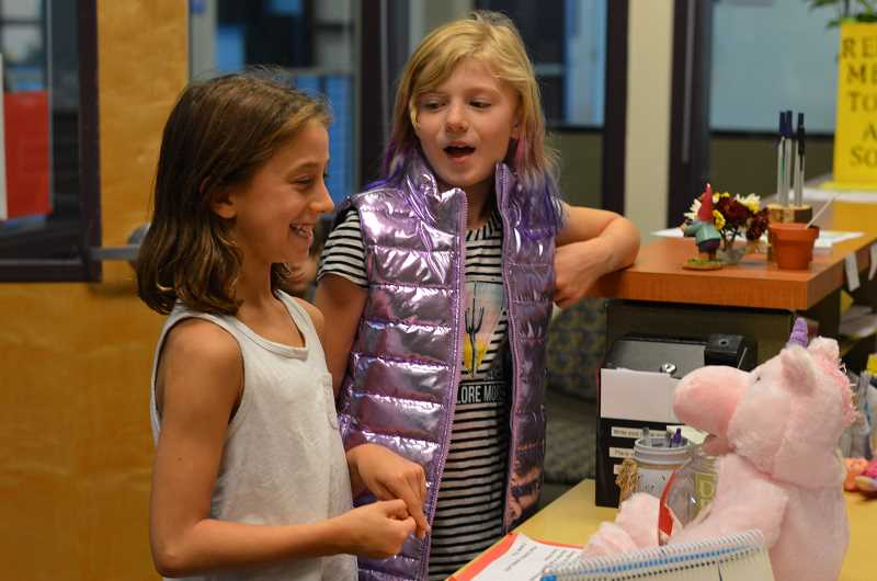 TIDINGS PHOTO: CLARA HOWELL - Willamette Primary fourth-graders Mya Ganey (left) and Scout Dennis (right) are part of the two classes of students involved with leading the Red Cross fundraiser.