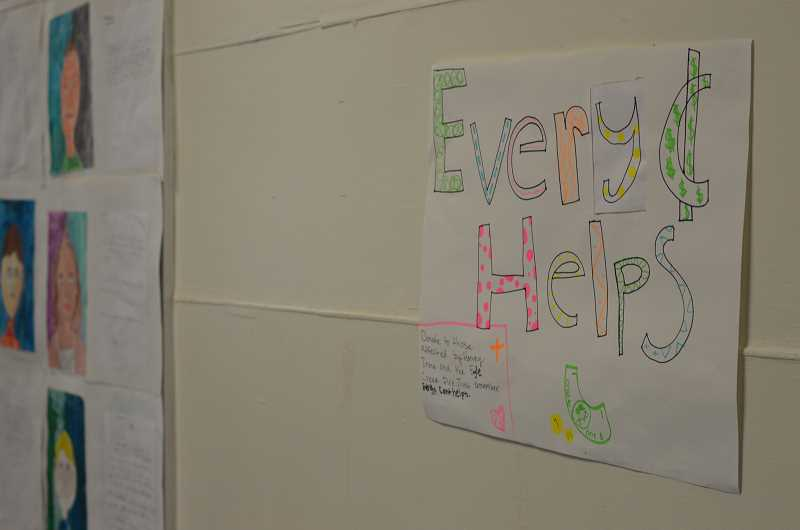 TIDINGS PHOTO: CLARA HOWELL - Two classes at Willamette Primary take charge with creating posters and promoting the Red Cross change drive for disaster relief.